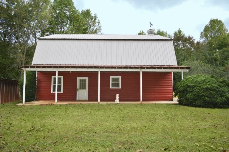 Only Partially Renovated This 1007 Square Foot Classic Red Barn Has The Potential