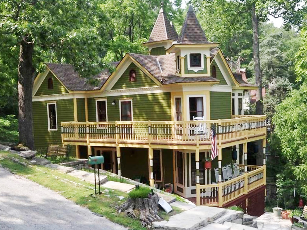 3 houses for sale with double decker porches historic for Home builders arkansas