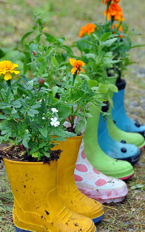Above all, your garden should have an organic, relaxed vibe. Forgo rigid wooden planters for something fun, like these rain boot alternatives.<br />Get the tutorial for these planters at Rosy Posy.<br />