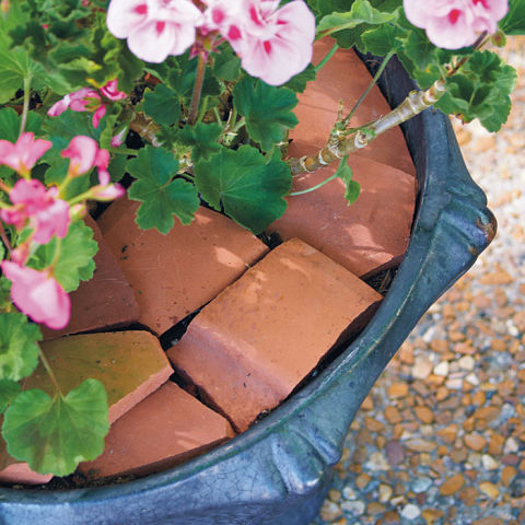 Terracotta shards can keep squirrels and other critters from digging through your container gardens. See more at Garden Gate »