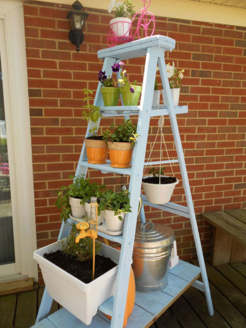 For a decidedly less construction-heavy project, neatly stack pots on the rungs of a ladder. For a bit more flourish, add a hook for a hanging planter.&lt;br /&gt;&lt;br /&gt;<br /> Get the tutorial at Small Town Rambler.&lt;br /&gt;&lt;br /&gt;<br />