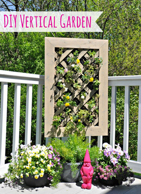 This vertical garden has its very own irrigation system: At the center of the structure, there are two PVC pipes with holes drilled in them for even water distribution.&lt;br /&gt;&lt;br /&gt;<br /> Get the tutorial at Decor and the Dog.&lt;br /&gt;&lt;br /&gt;<br />