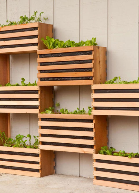 If you prefer a clean, minimalist aesthetic, stacked cedar boxes attached to the side of your home make for a striking vertical garden.&lt;br /&gt;&lt;br /&gt;<br /> Get the tutorial at ManMade.&lt;br /&gt;&lt;br /&gt;<br />