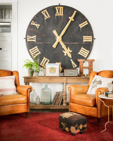 A weathered clock face hung on Paris's Boulevard Saint-Germain in the late 1800s acts as a statement piece in the living room of singer-songwriter Holly Williams' 1908 Nashville cottage.