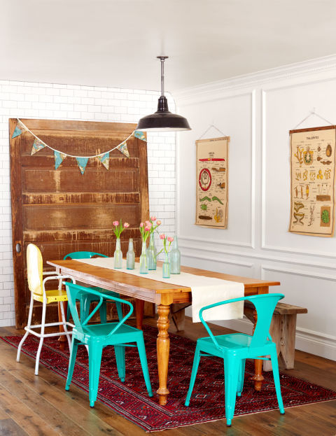 The centerpiece of the dining room in this Arizona ranch home is a giant pocket door that was salvaged from an old warehouse and trimmed with a map pennant. The scuffed-up door establishes the room's layered-over-time vibe, making the secondhand farm table, mismatched seating, and garage sale rug look cool and collected, not hodgepodge.</p> <p>