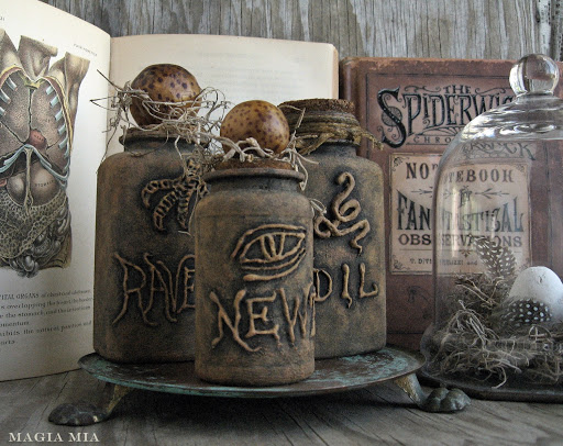 No witch's home would be complete without an apothecary of snake oil, newt's eye, toad stool, and raven feet. These DIY bottles were made using plastic vitamin bottles, hot glue, and several coats of black and brown chalk paint. 