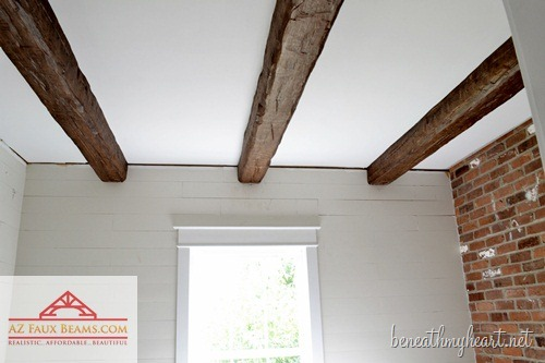 Fake ceiling rafters are a great way to add country character. Blogger Traci of Beneath My Heart used artificial beams to dress up her bathroom and hide an unsightly pipe. 