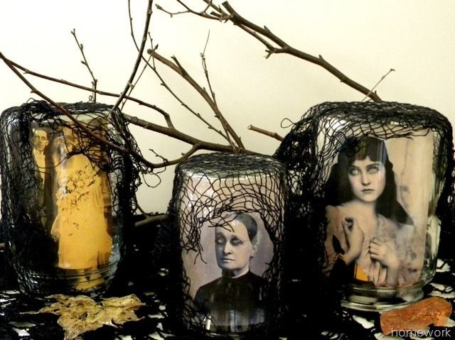 Take vintage portraits, cover the eyes with glow-in-the-dark paint, and roll them to fit into jars. The subjects' eyes seem to follow you around the room, and layers of black netting and twigs add to the haunting effect. 
