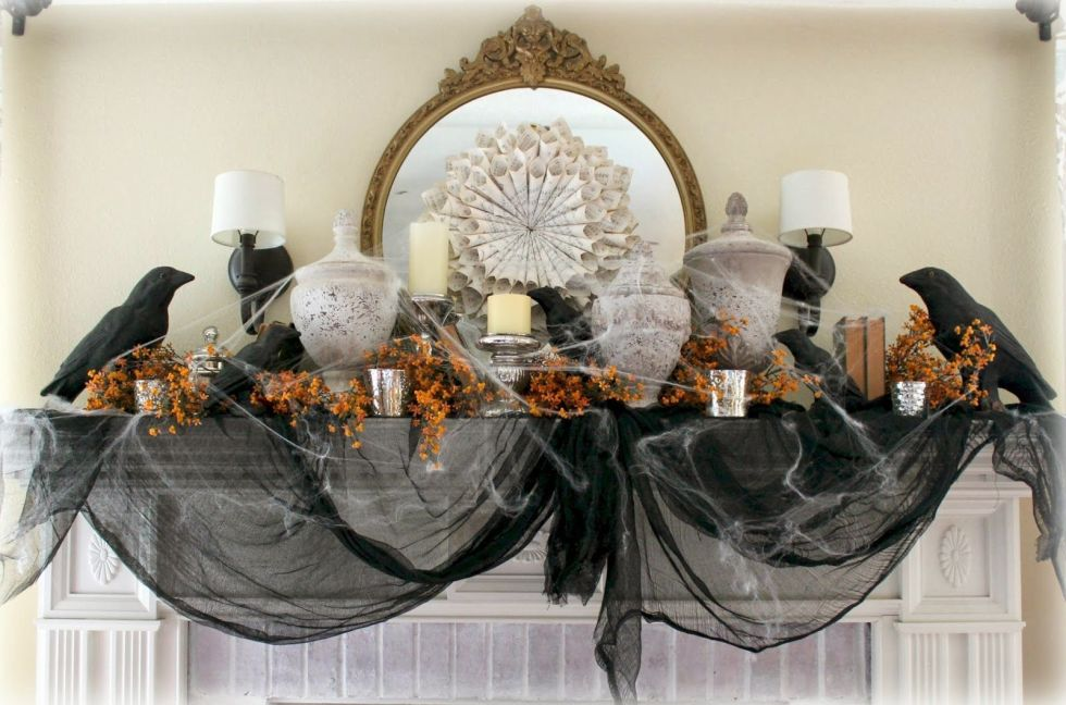 Old book pages, crows, and a healthy dose of black gauze give this elegant fireplace mantel a spooky vintage vibe. 