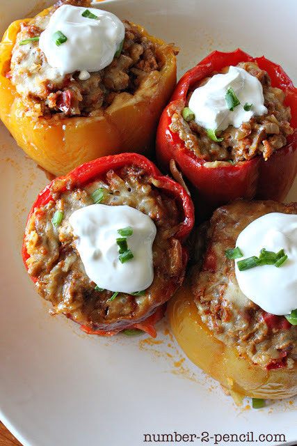 Top these beef-filled peppers with a dollop of sour cream and a sprinkle of green onions. 