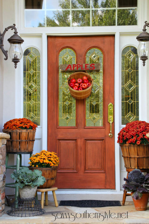 When it comes to curb appeal, your front door is prime real estate. This year, create an eye-catching display by forgoing a classic wreath for a creative seasonal display, like an apple basket.  See more at Savvy Southern Style.  MORE: 12 Festive Fall Door Decorations That Aren't Wreaths