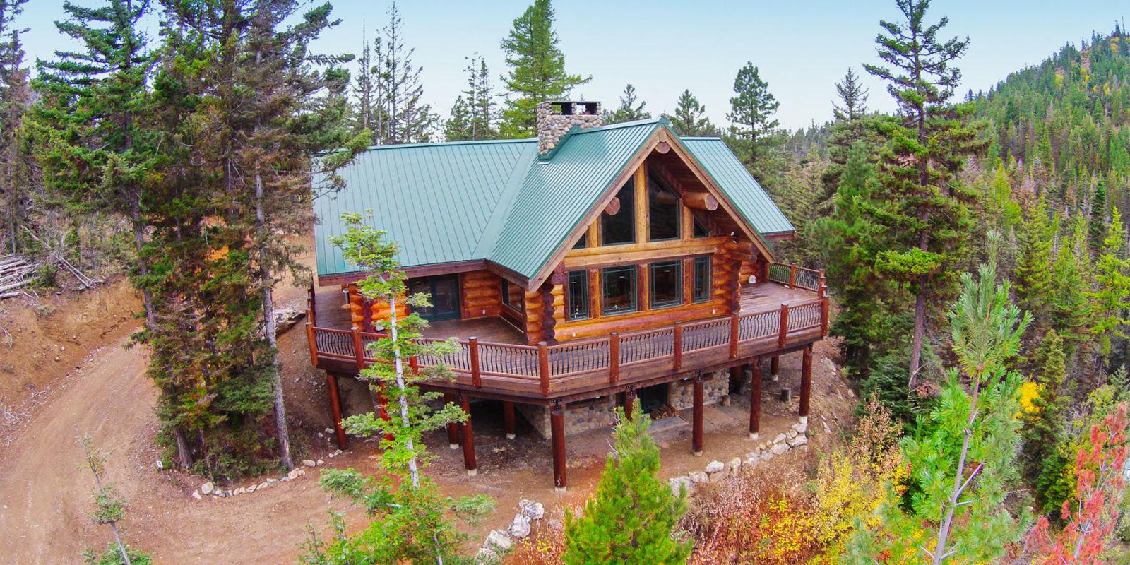 The history of log cabins how log cabins have for Log home landscape design