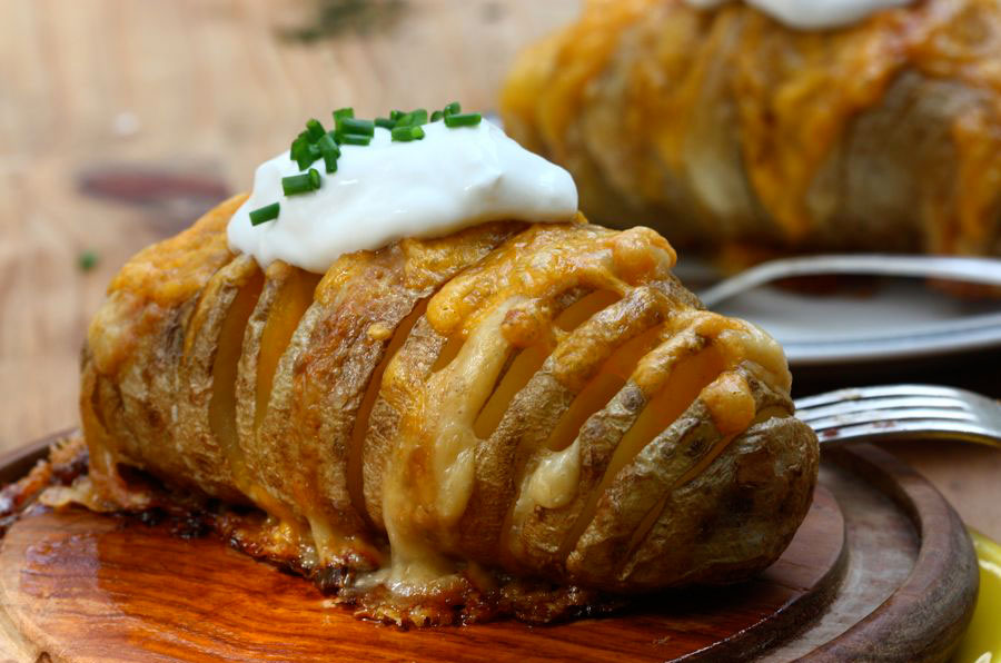 If you like baked potatoes, you'll love this flavorful recipe that stuffs butter and parm between the ridges of a sliced-up potato.  Serve with Cheddar cheese and a dollop of sour cream. Get the recipe from A Cozy Kitchen at Tasty Kitchen.