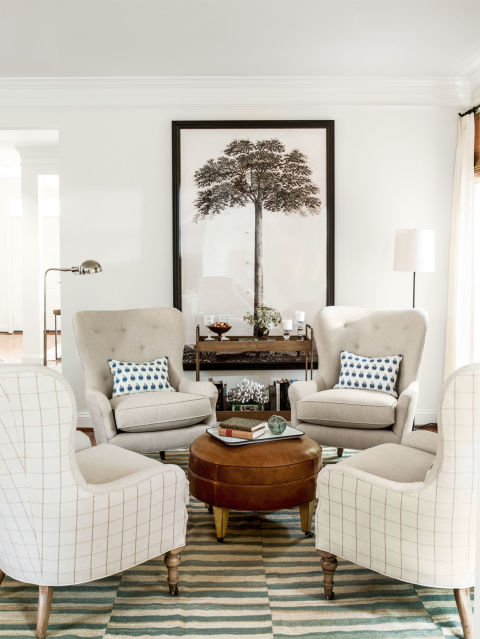 Large photo as a tree makes a beautiful piece to hang on the wall in this neutral living room from Country Living  ||  Friday Favorites at www.andersonandgrant.com