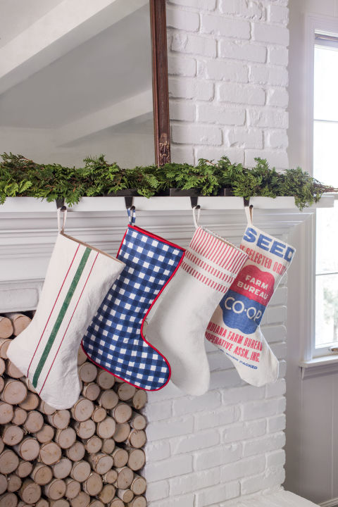 Add country flair to your mantel with stockings in designs of a seed sack, gingham, ticking stripes, or a grain sack.