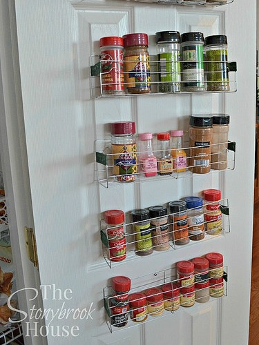 You have to try this double-duty organization idea: Just bend cookie cooling racks from the dollar store, then hang them on your door to add extra storage in your pantry. See more at The Stonybook House »