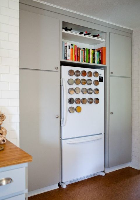 You hang notes and pictures on the front of your refrigerator — so why not your spice collection? Tins with magnetic backs add color to this all-white appliance and put what's more important in the kitchen (the taste of the food!) first. See more at The Kitchn »