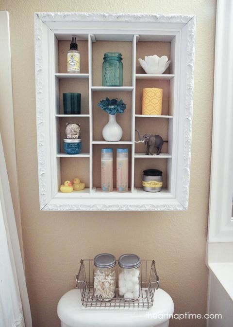 """Make this chic, exposed bathroom """"cabinet"""" to hold all your soaps, lotions, and shampoos. Get the tutorial at I Heart Naptime."""
