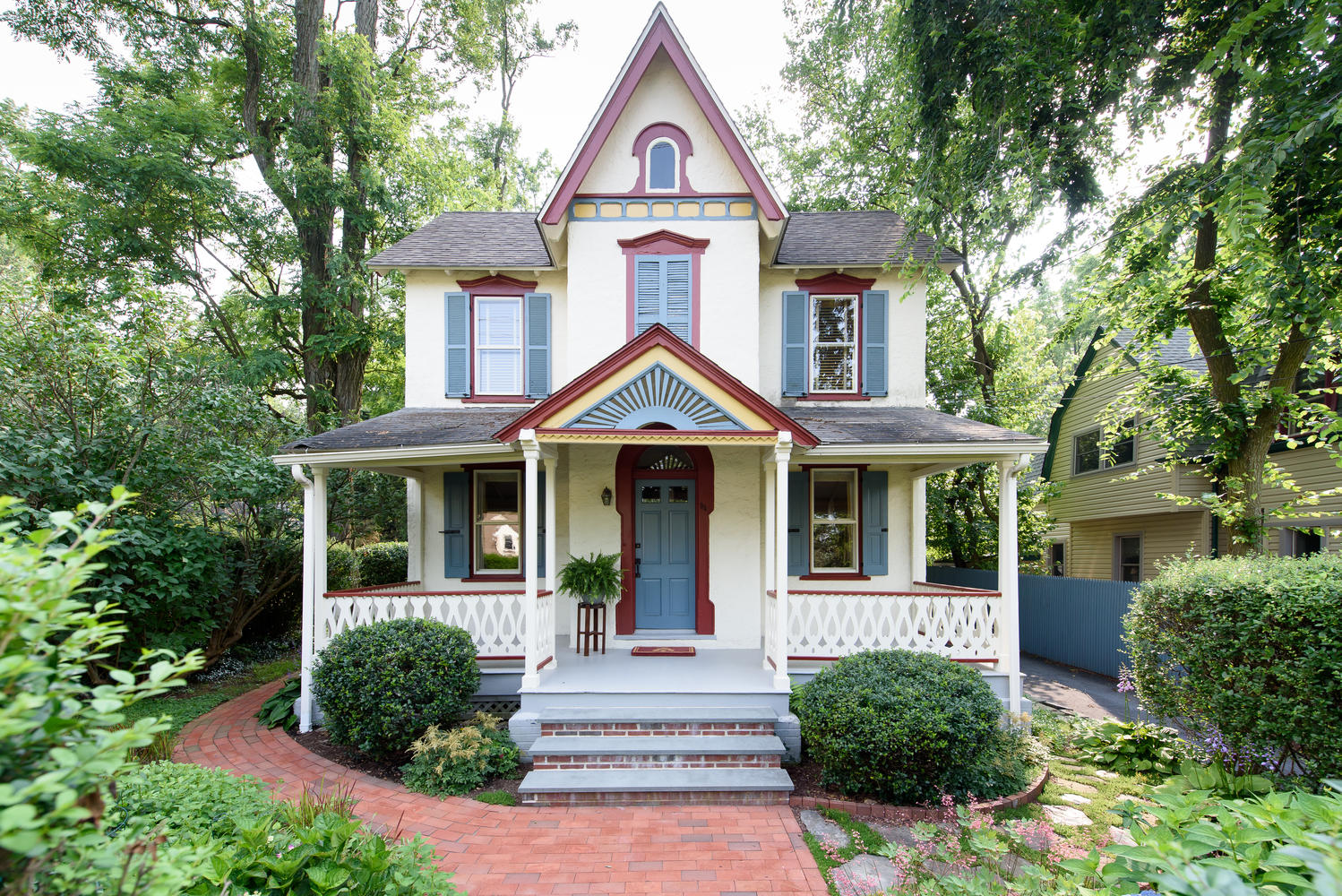 This victorian farmhouse for sale looks just like a dollhouse for Farmhouse style homes for sale