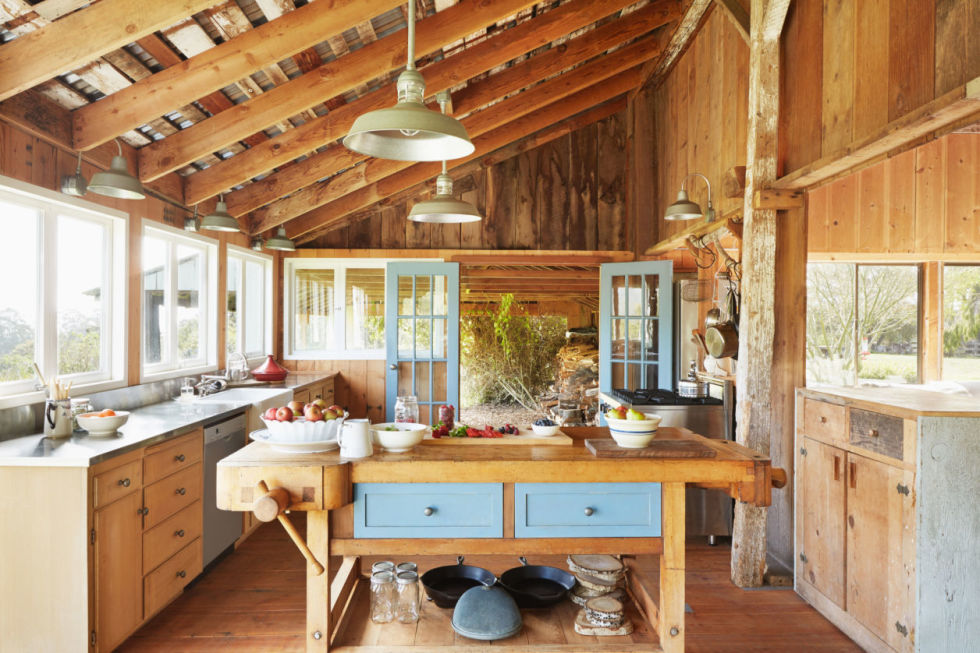 exposed beams windows galore and a big wooden island with room for all