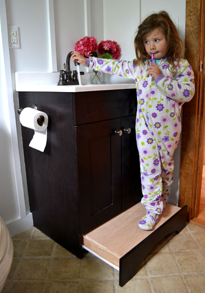 Instead of keeping a clunky step stool in your bathroom, tuck one inside a drawer that little ones can use, then push out of sight when they're done washing up before bed.<br />See more at Ana White »<br />