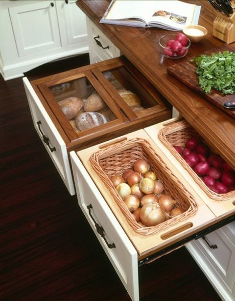 Did you know that onions and potatoes spoil faster when stored together? That's why this separate basket drawer (complete with a bread box to keep rolls from going stale) is something you need ASAP.<br />See more at The Kitchn »<br />