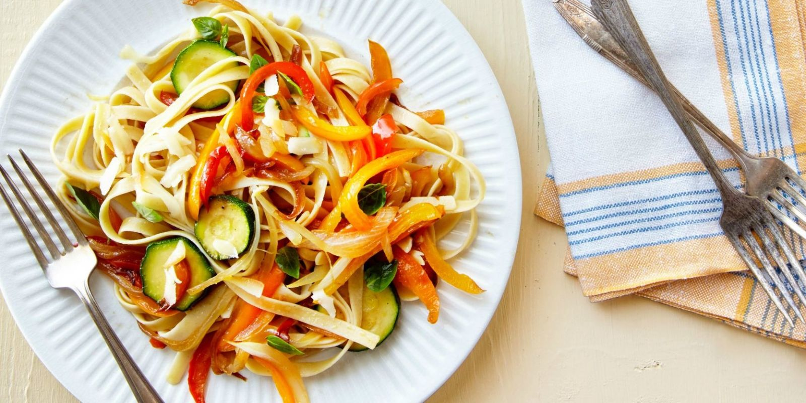 Pasta With Saut 233 Ed Peppers Zucchini And Smoked Mozzarella Recipe Countryliving Com