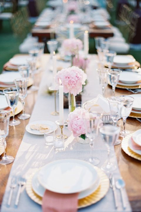 When you have such stunning peonies, what else do you need? Not much! Soft pink peonies in bud vases take center stage in this simple setting. Photo by Michael + Anna Costa.