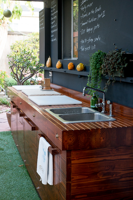 This freestanding outdoor kitchen unit, designed by the bloggers behind The Horticult, was built on wheels so it could easily be moved. A giant chalkboard wall is the perfect place to write menus and to-do lists.See more of this backyard at The Horticult.