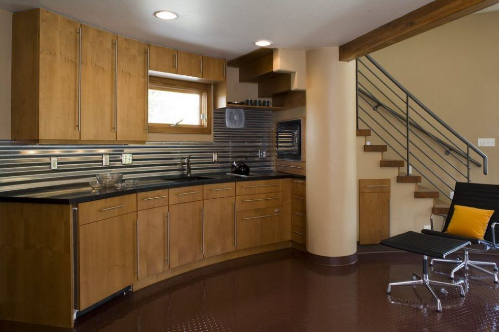The home's widest diameter measures 27 feet. Under the stairs, the kitchen follows the curvature of the house.
