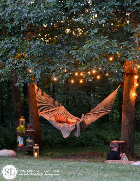 backyard string lighting ideas. is there anything more soothing than a hammock gently swinging under string lights this easytopulloff setup guaranteed to be your favorite spot backyard lighting ideas