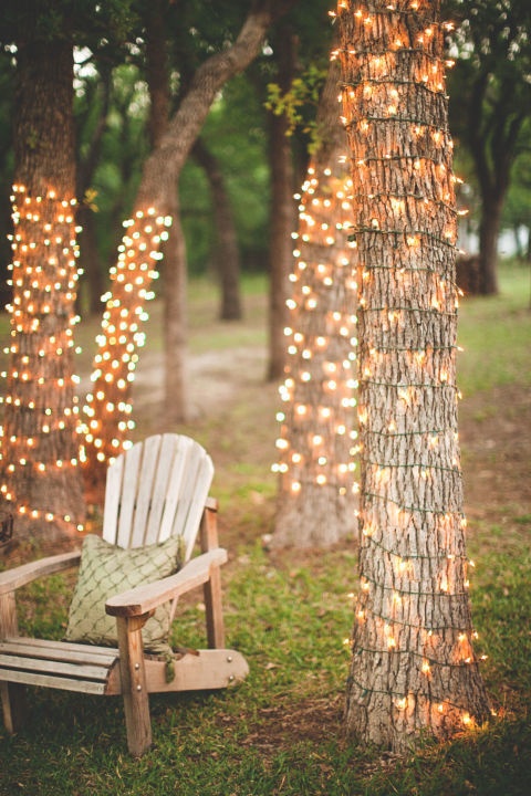 create a romantic spot by twisting a string of white lights around a cluster of trees in your backyard not only will this create an enchanting place to sit - Patio Lights String Ideas