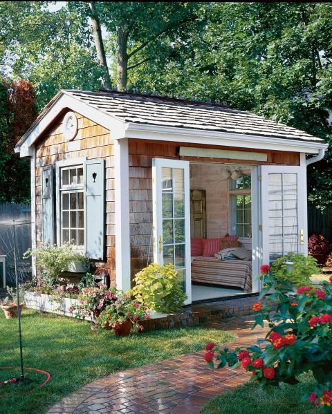 With a cozy daybed and French doors that swing open to a charming and lush garden, this she-shed is the ultimate spot for whiling away a summer afternoon.<br />