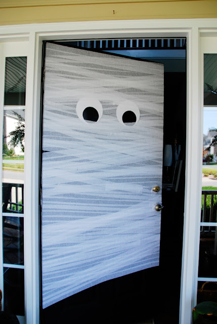 Mummify your front door using white streamers, double-sided tape, and black and white construction paper. Your house will definitely look ready for trick-or-treaters!