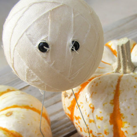 Grab a styrofoam ball, muslin, and tea bags and you'll have a mummy fit for any mantel. 