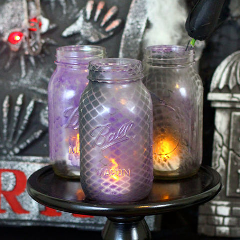 Spray paint, fishnets, and battery-operated tea lights turn Mason jars into decorative displays. Get the tutorial at Homemaking Hacks.  What you'll need: glass jars ($12 for 20; amazon.com), fishnet stockings ($7; amazon.com), purple spray paint ($7; amazon.com), battery operated tea lights ($9 for 12; amazon.com).