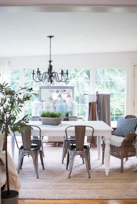 A weathered thrift shop centerpiece can be left out even after dinner guests have said goodbye. To give your space an easy, breezy vibe, mix and match metal chairs with wicker furniture.<br />See more at Zevy Joy.<br />
