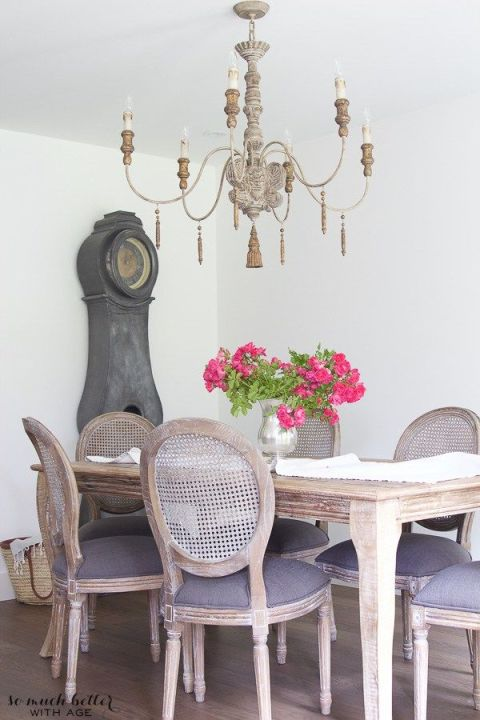 While this dining set and lighting fixture may have looked more formal with a darker wood stain, their shabby chic finish keeps the room casual.<br />See more at So Much Better With Age.<br />