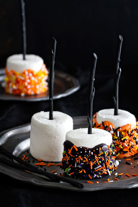 Decorative desserts make for the perfect sweet-tooth treat this Halloween. Your guests will love these chocolate-coated marshmallows stuck with black lollipop sticks.  Get the tutorial at My Baking Addiction.