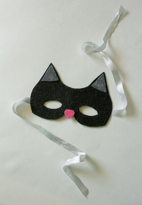 If your little one is looking for the perfect piece to finish her black cat costume, this is the mask to make. You'll need half a sheet of black glitter felt, scrap pieces of gray and pink felt, scissors, Mod Podge, a brush, a pair of glasses or sunglasses for measuring, and some sparkly ribbon. Get the tutorial at See Kate Sew.
