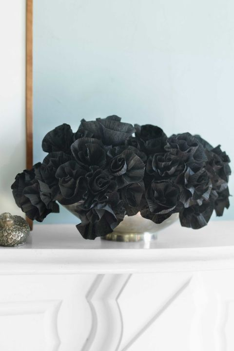 Take typical harbingers of good cheer to the dark side. This shadowy floral arrangement is made from inexpensive crepe-paper streamers. 