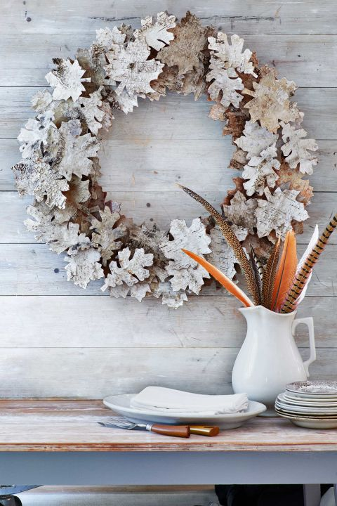 "Birch bark is the key to these autumn ""leaves."" You'll need twenty-four 6 3/4""W x 20 1/2""L sheets of birch bark, a 20-inch-diameter foam wreath form, and 45 small wooden cubes to act as risers. First, print and cut out our oak- and maple-leaf templates. Trace 75 assorted leaves onto the birch-bark sheets, and cut out. Varying the leaf type, hot-glue 30 leaves onto the wreath form. Then, hot-glue a wooden cube onto the back of each remaining leaf. Using our photo as a guide, hot-glue the cube-backed leaves atop the original leaves.
