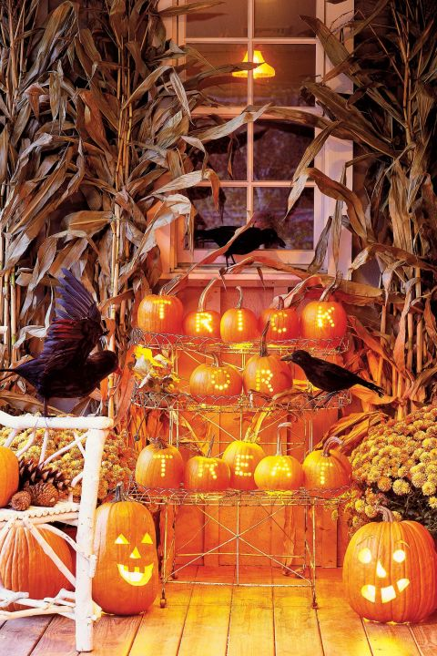 Spell out your greeting in mini pumpkins gathered at a prominent — and stationary — location. First, pencil letters on hollowed pumpkins (carve out the opening from the bottom). Then, using a drill with a half-inch bit, bore holes to form each letter. Here, strings of Christmas-tree lights, gathered in small bunches, illuminate each pumpkin (unscrew bulbs where the string descends to the next row).
