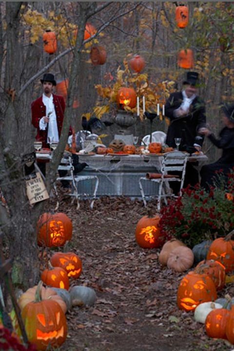 Add a vintage vibe to your soiree by asking guests to dress in period garb, keep decorations simple (like they would have in old times!) and use Jack-O'-Lanterns to light the way to a backyard dinner party.