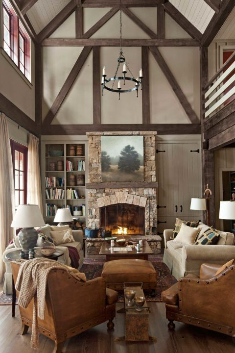 French leather club chairs from Wyatt Childs, plus a pair of Mitchell Gold + Bob Williams sofas, serve up plenty of cozy seating in this Georgia lake house.