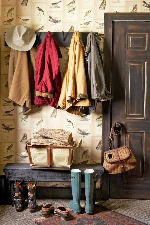 The owner of this Adirondack-style home lined her mudroom using color copies of seven antique bird prints bought for $7 each, making boots and brightly colored jackets pop against the wall.