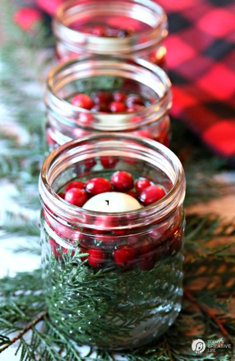 In just five minutes, you can create these stunning luminaries using jars (Mason jars are our pick, but pickle jars work just as well), cranberries, cedar clippings or something green, and floating candles. See more at Today's Creative Life.