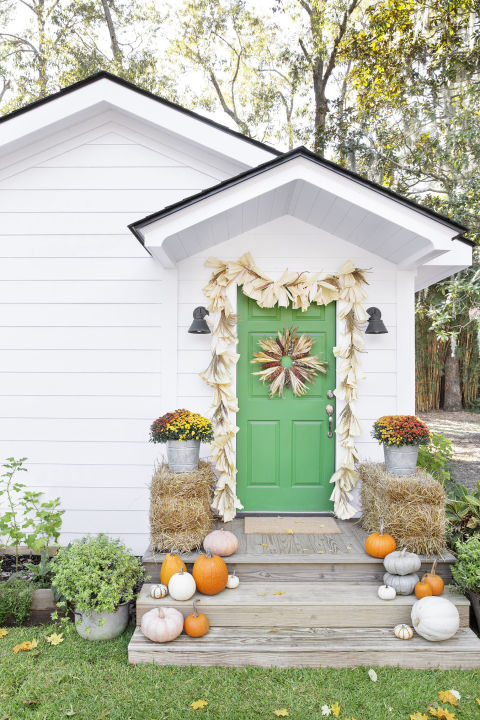 Add seasonal curb appeal with these easy DIYs.  For the garland: Cut a piece of ½-inch jute rope to your desired length (add a few extra inches to get the drapey effect at the top) and attach corn husks and silks with a hot-glue gun. (You can also use tamale wrappers.)  For the wreath: Start with a flat-wire 18-inch frame. Hot-glue corn husks (roughly 18) and corncobs (roughly 9) in an alternating pattern. Fray the ends of the corn husks to add more dimension.