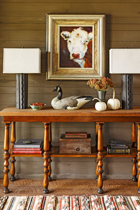 No need to go overboard: Place two small white pumpkins on an entryway table to greet guests with a smattering of fall spirit.