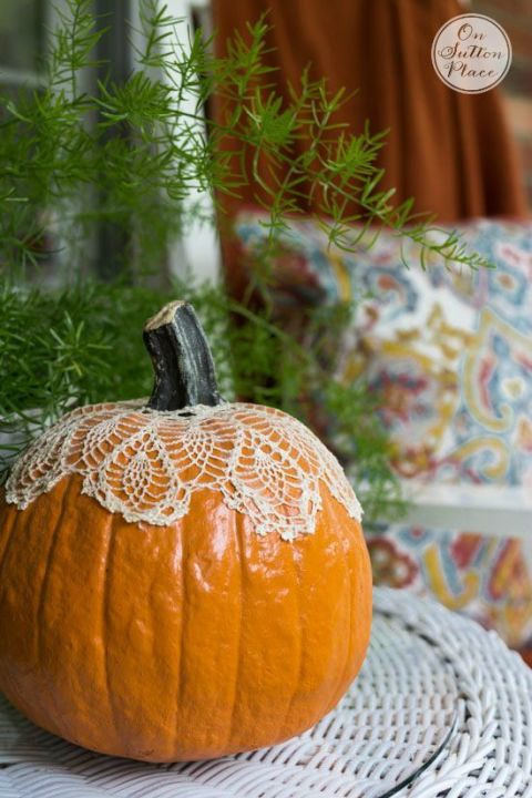 Not all pumpkins need to be carved into a spooky scene. By adding a lace doily over the stem, the pumpkin becomes a bright focal point on your front porch. 